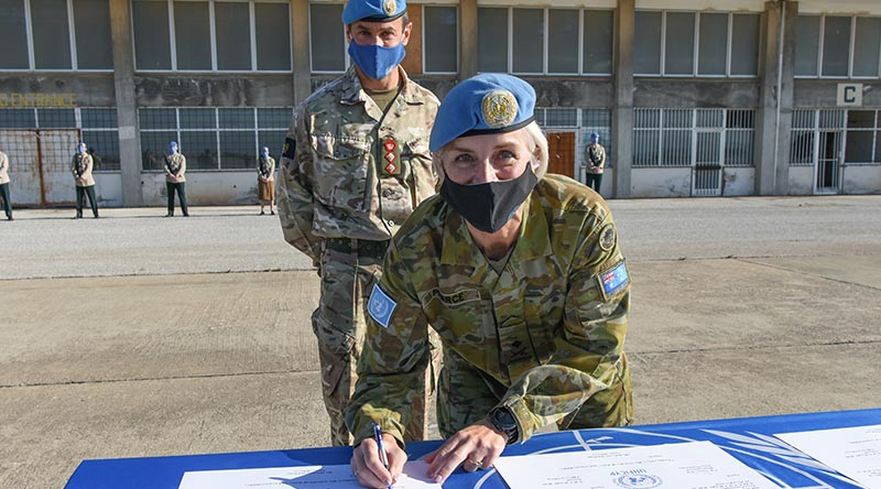 Major General Cheryl Pearce signs a Transfer of Authority certificate appointing Colonel Neil Wright as acting Officer in Charge of the military components in Cyprus until the new force commander arrives. Photographer unknown.