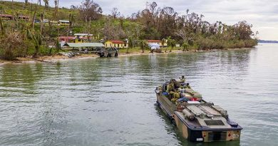 Australian soldiers from the 10th Force Support Battalion drive a LARC5 (light amphibious resupply cargo) onto Galoa, Fiji with humanitarian-assistance supplies. Photo by Corporal Dustin Anderson.