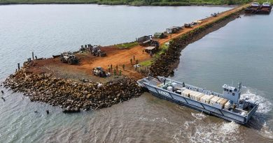 A Navy landing craft delivers disaster-relief supplies at Bekana Jetty in Vanua Levu, Fiji, during Operation Fiji Assist. Photo by Corporal Dustin Anderson.