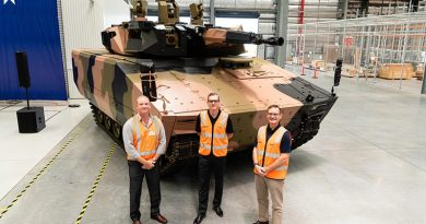 Minecorp Australia General Manager Angus McIntyre, Rheinmetall Defence Australia General Manager Land 400 Phase 3 Lee Davis and RDA Managing Director Gary Stewart with one of three Lynx now in Australia for assessment. Photo supplied.