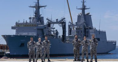 Marine Technicians Able Seamen Greg Hallet, Cassandra Bullock, Mason Turner, Cody Martin, Yassi Coban and Leading Seaman Morse Stanton in front of NUSHIP Supply at Fleet Base West, Western Australia. Photo by Leading Seaman Ronnie Baltoft.