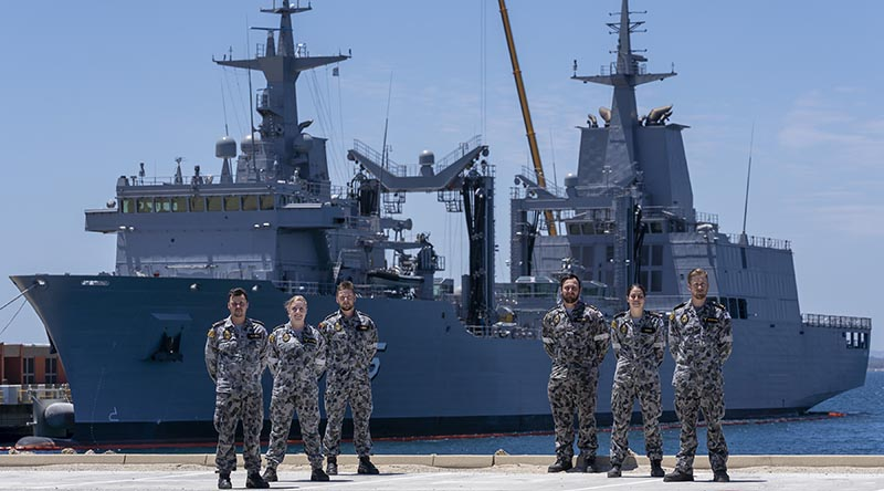 Marine Technicians Able Seamen Greg Hallet, Cassandra Bullock, Mason Turner, Cody Martin, Yassi Coban and Leading Seaman Morse Stanton in front of NUSHIP Supply at Fleet Base West, Western Australia. Photo by Leading Seaman Ronnie Baltoft.