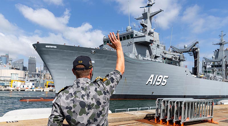 Commanding Officer of NUSHIP Supply, Captain Ben Hissink welcomes his ship to her home port, at Fleet Base East, Sydney. Photo by Leading Seaman Nadav Harel.