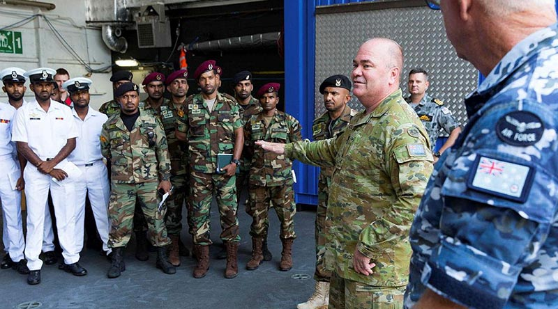 Major General Roger Noble welcomes members of the Sri Lankan Navy aboard HMAS Canberra at Colombo, Sri Lanka, during Indo-Pacific Endeavour 2019. Photo by Leading Seaman Steven Thomson.
