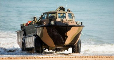 A LARC-V lands with soldiers of 2nd Battalion, Royal Australian Regiment during the amphibious assault at Fog Bay in the Northern Territory for Exercise Talisman Sabre 2015. Photo by Sergeant Mark Doran.