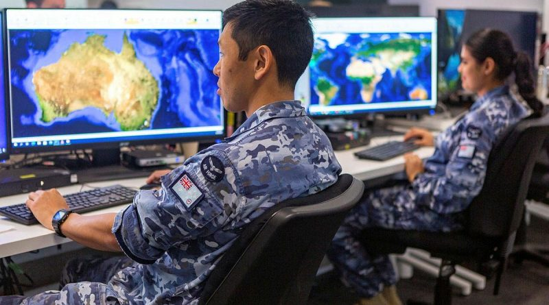 Corporal Yasunari Fujimura and Aircraftwoman Amandeep Kaur, from Distributed Ground Station – Australia, prepare for last year's Exercise Coalition Virtual Flag. DGS-AUS is now No. 83 Squadron. Photo by Leading Aircraftwoman Jacqueline Forrester.