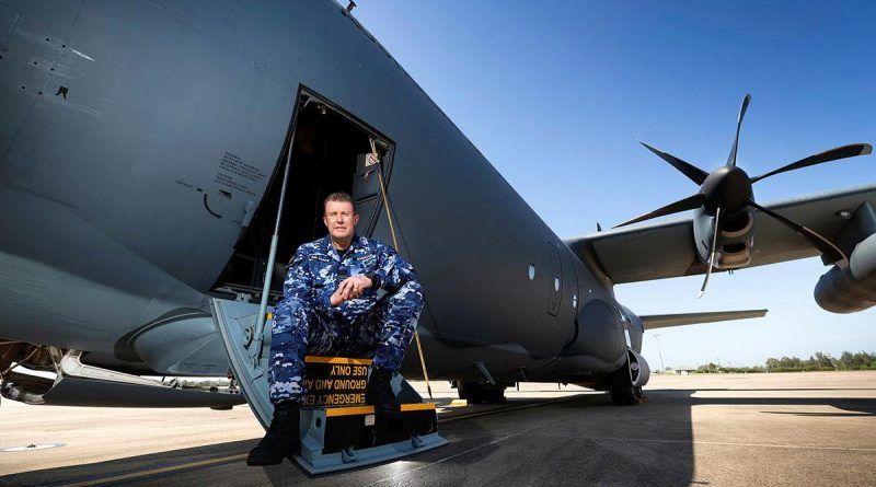 Specialist Reserve Public Affairs Officer Wing Commander Peter Overton on the steps of a No. 37 Squadron C-130J Hercules. Photo by Corporal David Said.