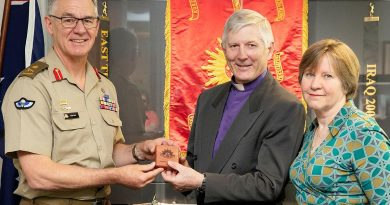 Chief of Army Lieutenant General Rick Burr presents a Federation Star to Bishop Grant Dibden alongside his wife Janet at Russell Offices, Canberra. Photo by Petty Officer Lee-Anne Cooper.