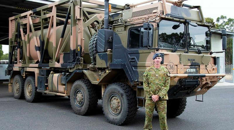 Warrant Officer Class 2 Lance Keighran in front of a MAN HX77 truck at the Army School of Transport in Puckapunyal, Victoria. Photo by Corporal William Spence.