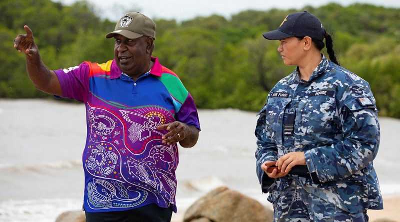 Indigenous Liaison Officer Flight Lieutenant Kristal House engages with Deputy Chair of the Kauareg Native Title Elizah Wasaga on the King's Point beach at Ngurupai (Horn Island) in the Torres Strait. Photo by Corporal Jesse Kane.