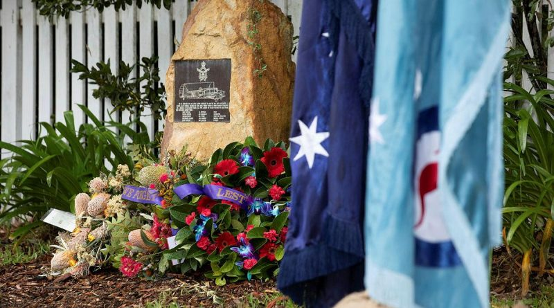 Wreaths surround the memorial plaque at the rededication service commemorating the 80th anniversary of the RAAF Anson A4-5 crash at Glenbrook, NSW. Photo by Corporal Kylie Gibson.