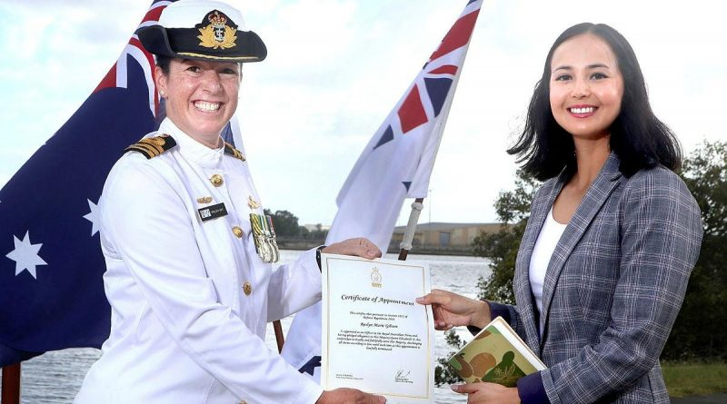 Commanding Officer HMAS Moreton Commander Phillipa Hay appoints Roslyn Gibson to the Royal Australian Navy during a ceremony in Brisbane.