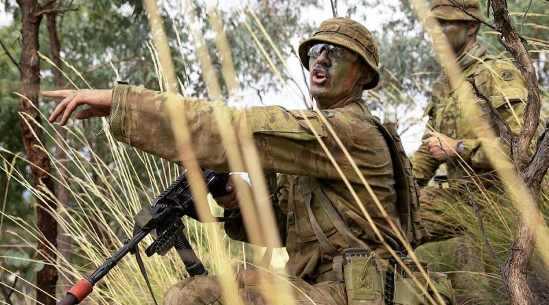 Army Officer Cadet Lachlan Goodall gives orders during a section attack at the Majura Training Area. Photo by Corporal Robert Whitmore.