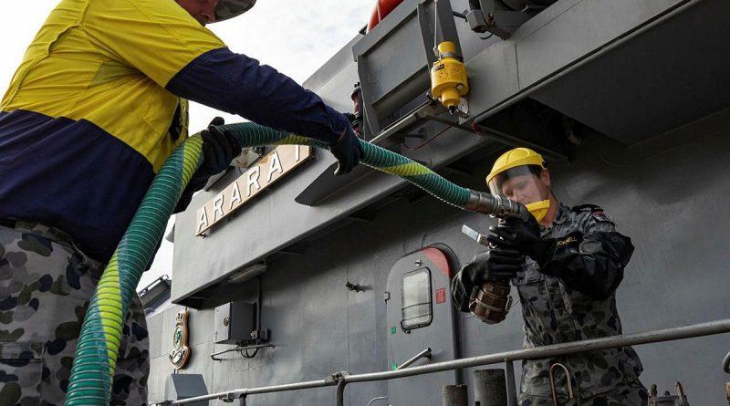 Leading Seaman Jeffrey Drew, left, and Seaman Lachlan Bucknell, prepare to refuel HMAS Ararat at HMAS Coonawarra, Darwin. Photo by Leading Seaman Shane Cameron.
