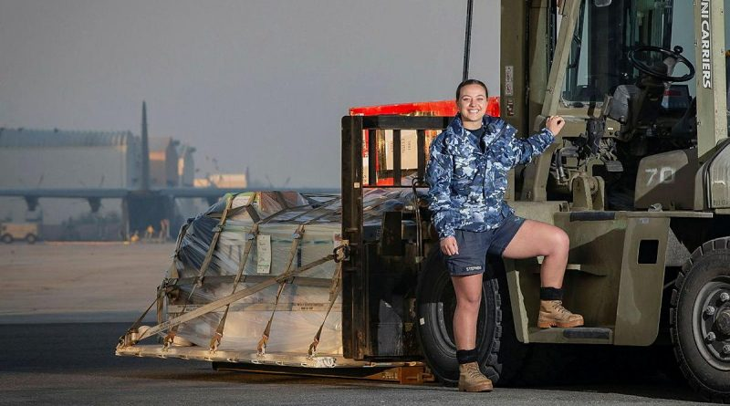 Leading Aircraftwoman Lisa Stephens prepares to load a C-130J Hercules in the Middle East region. Photo by Sergeant Ben Dempster.