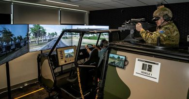 Forces Command Major Andrew Bone and Signaller Jon Taylor, rear, test the new Protected Mobility Tactical Training System at the Battle Simulation Centre, Gallipoli Barracks, Enoggera. Photo by Private Jacob Hilton.