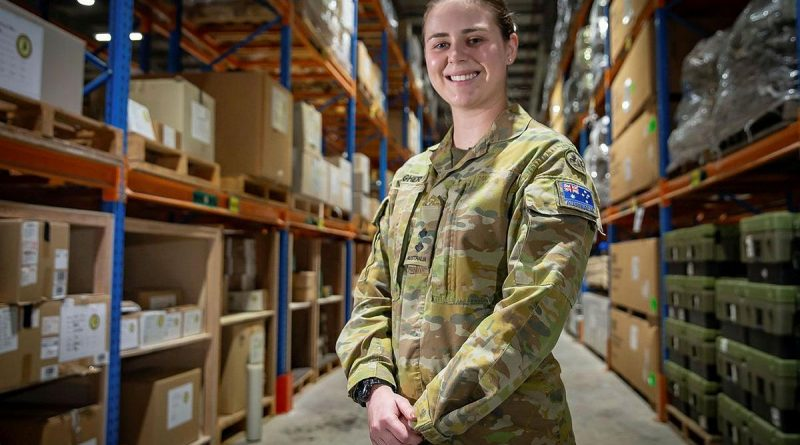Lieutenant Madeline Meagher at the warehouse facility in the Middle East region. Photo by Sergeant Ben Dempster.