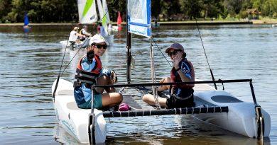 Aircraftwoman Ayumi Kono, left, and Aircraftwoman Samantha Shen enjoy a morning of sailing at Lake Burley Griffin, Canberra. Photo by Sergeant Janine Fabre.