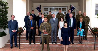 Corporal Gealan Toullea, front left, with Her Excellency Linda Hurley, front right, and guests at Government House in Canberra. Photo by Corporal Julia Whitwel.