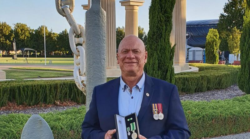 Former Chief Petty Officer Danny Joyce is awarded the Australian Service Medal at Anzac Park in Rockingham, Western Australia.
