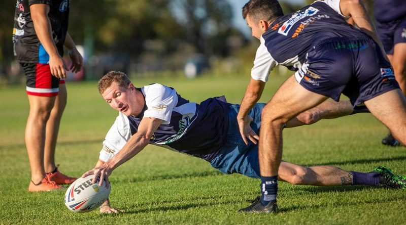 Petty Officer Stephen Swanson participates in a training session with the Navy Tridents rugby league team at the Lark Hill Sporting Complex in Port Kennedy, WA. Photo by Leading Seaman Ernesto Sanchez.