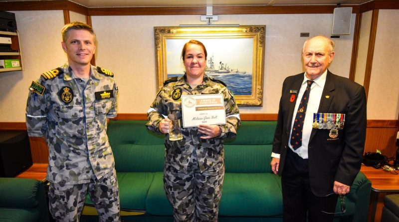 Commander Andrew Pepper with Able Seaman Melissa-Jane Bult and John Withers on board HMAS Hobart. Photo by Petty Officer Brendan Matchett.