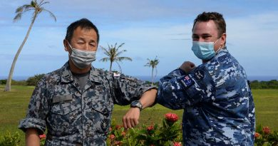 Chaplain Stuart Asquith shares a COVID-safe elbow tap with Warrant Officer Yoshiaki Tanide, of the Japan Air Self-Defense Force at Andersen Air Force Base in Guam. Photo by Technical Sergeant Jerilyn Quintanilla.