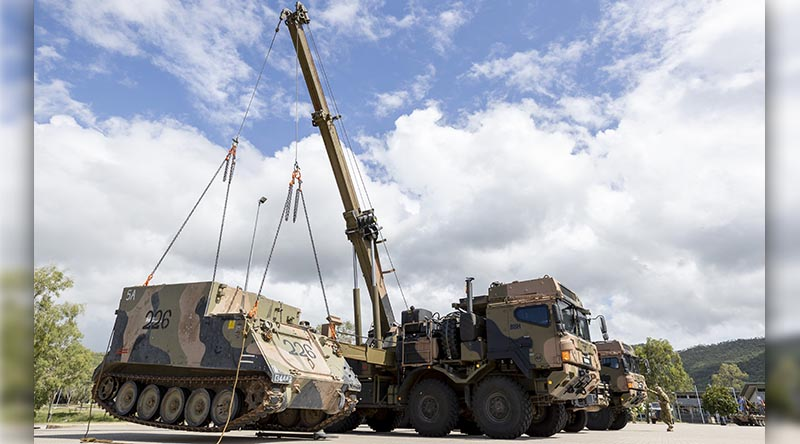 An Australian Army 45M heavy recovery vehicle from the 3rd Combat Service Support Battalion lifts an armoured personnel carrier during the 3rd Brigade combined-arms display at Lavarack Barracks, Townsville. Photo by Corporal Brodie Cross.