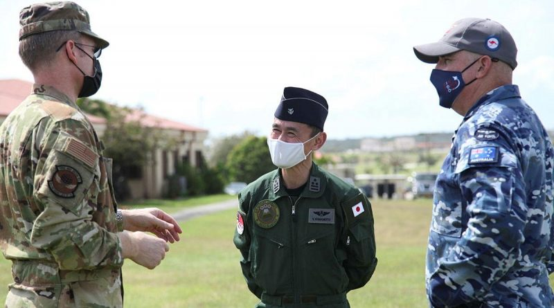 Lieutenant Colonel Adam Shockley from the US Air Force, Colonel Shinobu Yamamoto from the Japanese Air Self-Defense Force and Wing Commander Alan Brown from RAAF discuss operational matters during Exercise Cope North. Photo by Master Sergeant Masumi Suehara.