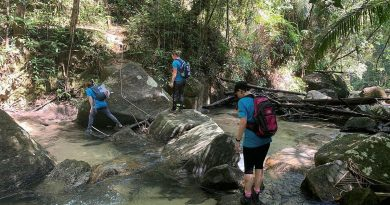 Greer Hawley, Flight Sergeant Sam Williams and Group Captain Gretchen Fryar hike through the hills of Pulau Pinang Malaysia to support the Rose Foundation.