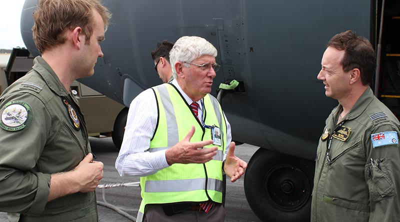 RAAF Museum Curator Dave Gardner speaks with Flying Officer Brett Aaker (left) and Squadron Leader Robert Sokol, pilots of the final C-130H Hercules flight to the RAAF Museum at Point Cook.