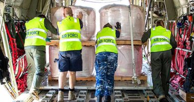 Air Force personnel unload fire retardant from a C-130J Hercules at Busselton Margaret River Airport in Western Australia. Photo by Leading Seaman Richard Cordell.