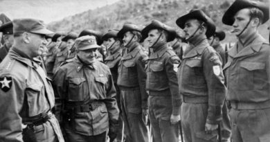 General J. van Fleet, General Officer, 8th US Army inspects members of the 3rd Battalion, Royal Australian Regiment (3RAR), while bestowing the presidential citation in recognition of the unit's action at Kapyong, Korea. AWM 083857