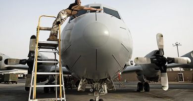Leading Aircraftman Nick Atterton cleans the windows on an AP-3C Orion in the Middle East. Photo by Able Seaman Paul Berry.