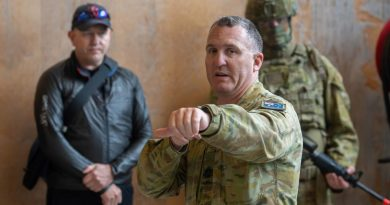 Regimental Sergeant Major Warrant Officer Class One Michael Carroll demonstrates urban clearing techniques to medical personnel during a visit to Gallipoli Barracks, Brisbane in 2020. Photo by Trooper Jonathan Goedhart.