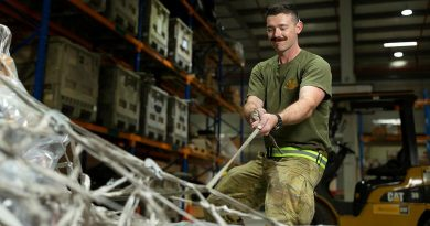 Private Mason Tessier secures cargo pallets in the warehouse of the ADF's main operating base in the Middle East, Camp Baird. Photo by Corporal Tristan Kennedy.