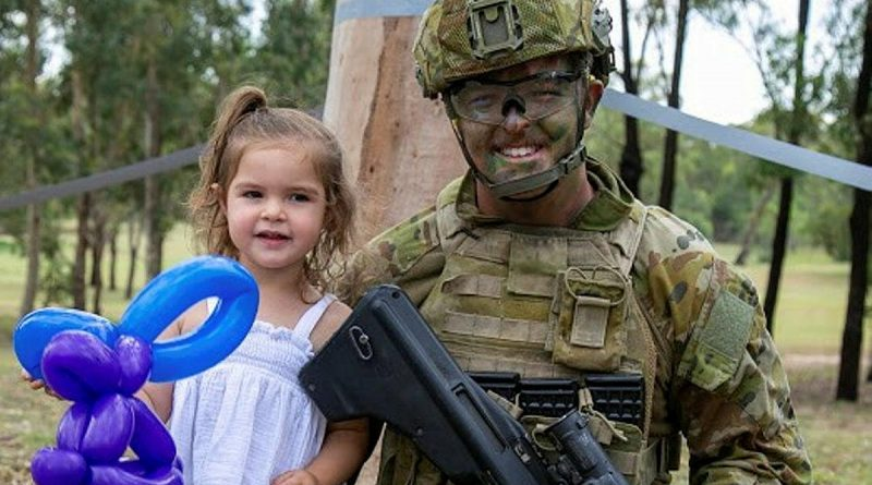 Private Jordan Enright, of the School of Infantry, enjoys the Singleton Military Area family day with his daughter. Photos by Corporal Shane Kelly.