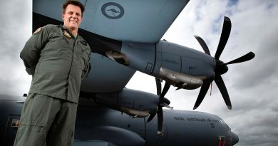 SQNLDR Michael Phillips with a No. 37 Squadron C-130J Hercules on the flightline at RAAF Base Richmond, NSW. Photo by CPL David Said.