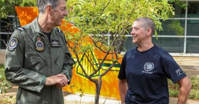 Senior Australian Defence Force Officer - Edinburgh precinct Air Commodore Ross Bender with Flight Lieutenant Lauren Hartley after she had her head shaved to raise money for the Lung Foundation Australia. Photo by Corporal Brenton Kwaterski.