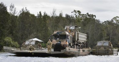 Students from the Bridge Erection Propulsion Boat course manoeuvre a bridge transporting a HX77 truck on the Georges River, Sydney. Photo by Petty Officer Lee-Anne Cooper.
