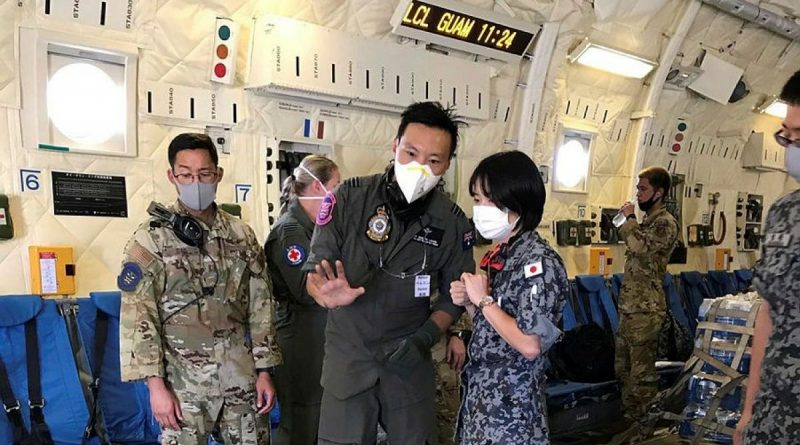 Medical Officer Flight Lieutenant Doctor Perlon Leung, centre, with Japan Air Self-Defense Force and United States Air Force colleagues in a JASDF C-2 during Exercise Cope North. Photo by Squadron Leader Emma Flack.