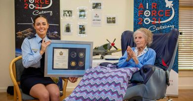 Leading Aircraftwoman Emma Singleton with the Chief of Air Force award presented to her great-grandmother Betty Howells to mark her 100th birthday. Photo by Sergeant Bill Solomou.