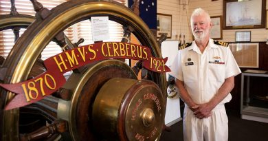 HMAS Cerberus Museum Manager Commander John Goss with historic items from HMVS Cerberus in the HMAS Cerberus Museum in Westernport, Victoria. Photo by Leading Seaman Bonny Gassner.