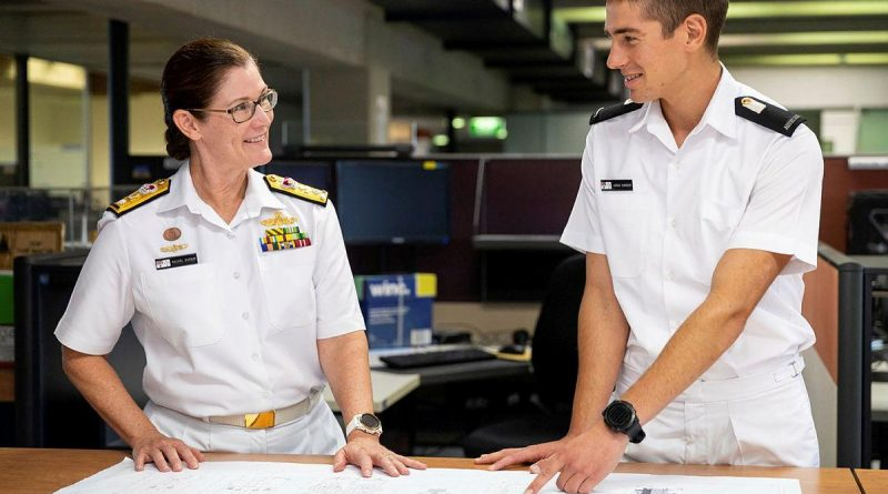 Director General Engineering - Navy Commodore Rachel Durbin speaks with Midshipman Jarad Barber at Campbell Park Offices in Canberra.