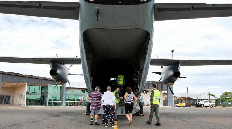 Flight Lieutenant Matthew Still, right, and Loadmaster Corporal Joanna Fletcher give residents a tour of a C-27J Spartan at Charleville Airport, Queensland. Photo by Leading Aircraftwoman Emma Schwenke.