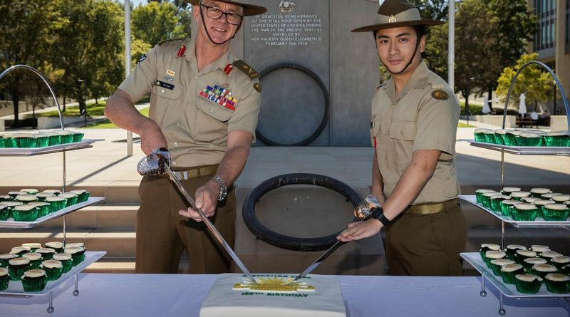 Chief of Army Lieutenant General Rick Burr, left, and Private Harrison Nguyen cut the cake during Army's 120th birthday celebrations in Canberra. Photo by Sagi Biderman.