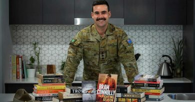 Captain Dylan Conway, of the 6th Battalion, Royal Australian Regiment, with books he read while bed-ridden after surgery. He later recommended books to others as part of his initiative, Brothers n' Books. Photo by Private Jacob Hilton.
