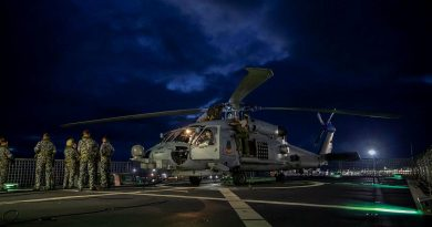 The MH-60R helicopter with the call sign Berserker being prepared for launch from HMAS Anzac. Photo by Leading Seaman Thomas Sawtell.