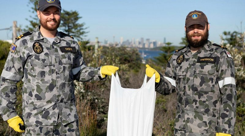 Sub-Lieutenants Nicholas Croke, left, and William Anderson from HMAS Watson participate in the Clean-Up Australia Day event in Sydney. Photo by Able Seaman Benjamin Ricketts.