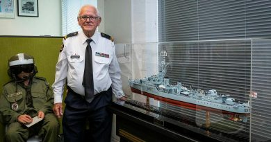 Gerry Shepherd with the scale model of HMAS Bataan he presented to the Navy History Section at the Sea Power Centre, Canberra. Photo by Sergeant Sebastian Beurich.